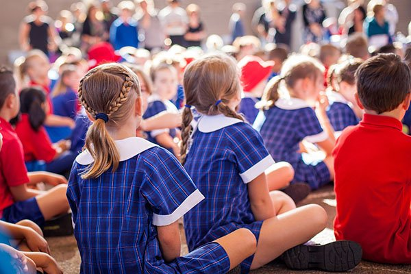 Children sitting at school assembly